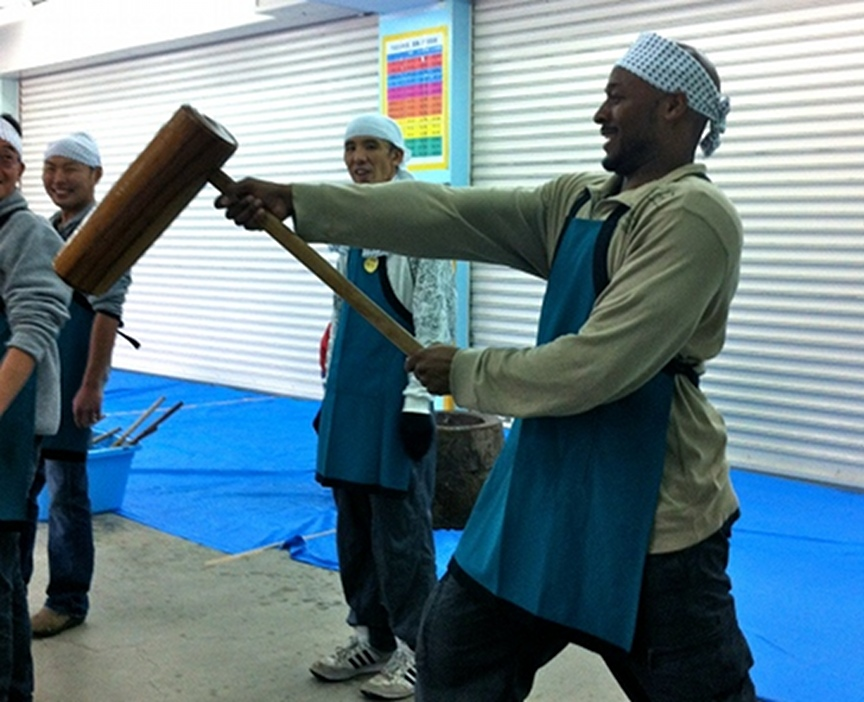 Holding a mochi hammer